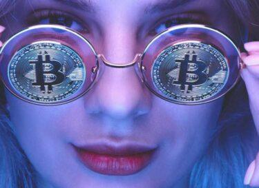 Bitcoin bril vrouw adobe stock